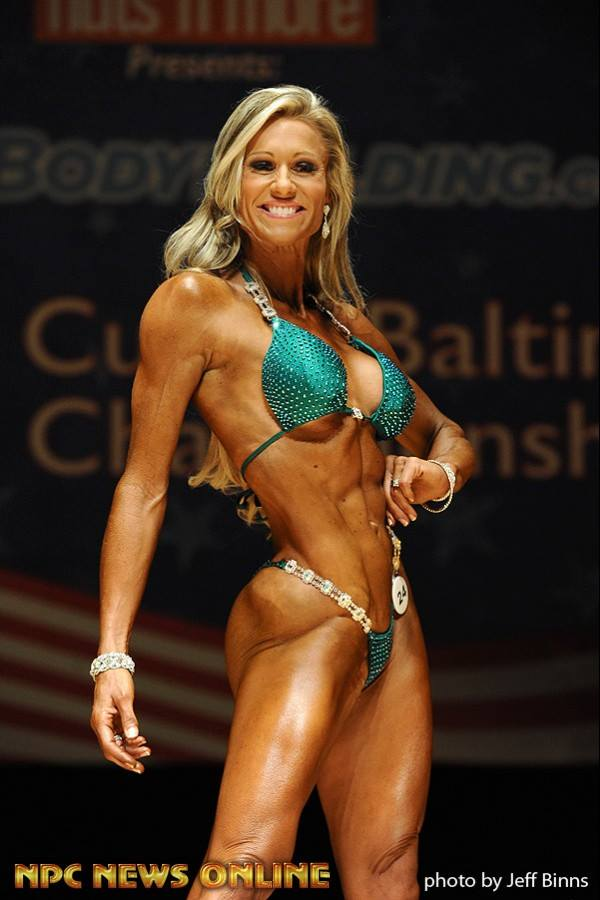 Discover How NPC Bikini Athlete Erica Cormier Conquered The Stage With The Confidence Of A Pro!Today No Stage Is To Bright for This Bikini Beauty!